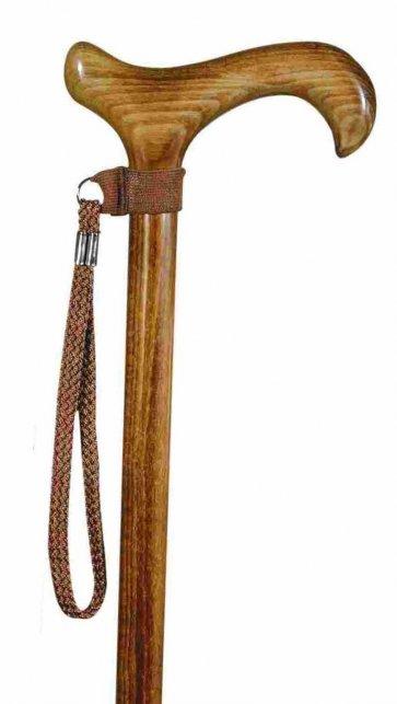 Handledsrem till käpp i brun färg, visas här på en träkäpp med derbygrepp