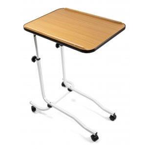 Bordet kan rullas in över sängen